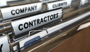 Close up on a file tab with the word contractors, focus on the main word and blur effect. Concept image for illustration of contractors or subcontractors company database.